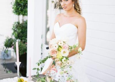 bride with floral arrangement