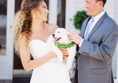 newlyweds with puppy