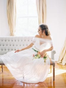 bride lays on white couch