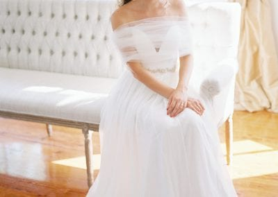 bride on white couch
