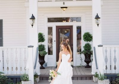 distant shot of bride with bouquet