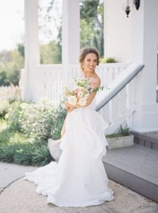bride with bouquet front steps