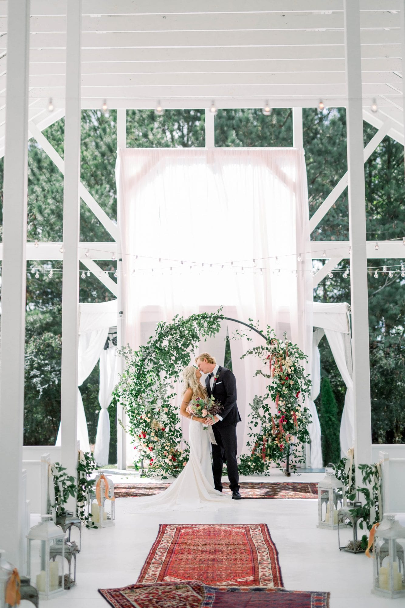 Covered arch & newlyweds