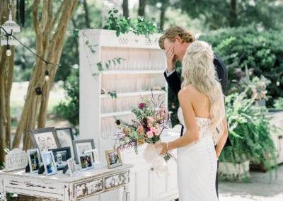 Groom tearing up at wedding photos