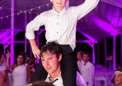 kid on groomsmen shoulders