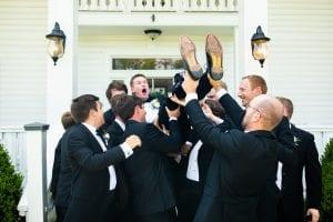 groomsmen lifting groom
