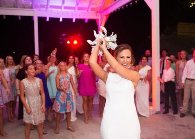 Bride throwing bouqet