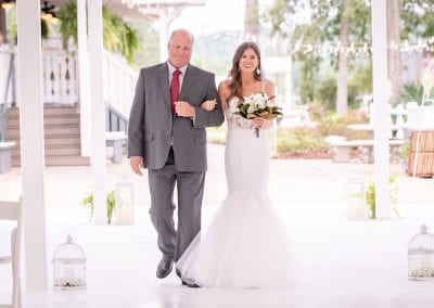 Bride being escorted down aisle