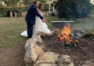 couple roasting marshmallows