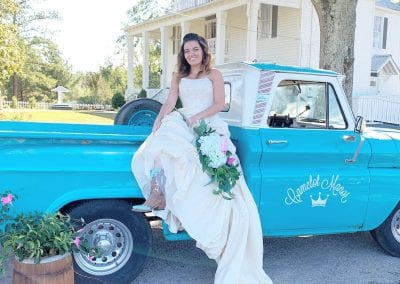 bride on blue truck