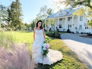 bride in front of manor