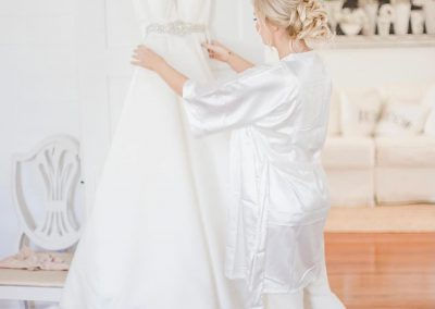 Bride and her dress in bridal suite at Camelot Manor