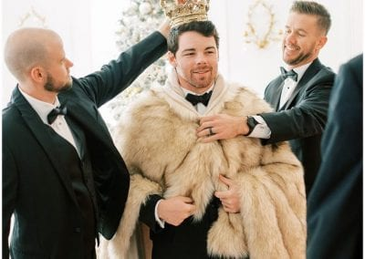 groom dressed up as a king