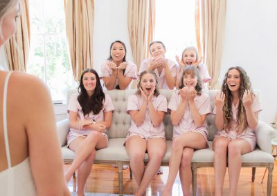 Bride reveals her dress to bridesmaids at Camelot Manor